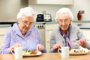 two old women eating foods